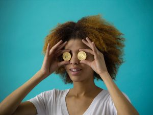 woman with two bitcoins over her eyes