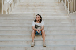 young man sitting on staircase