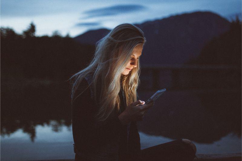 a woman texting at night