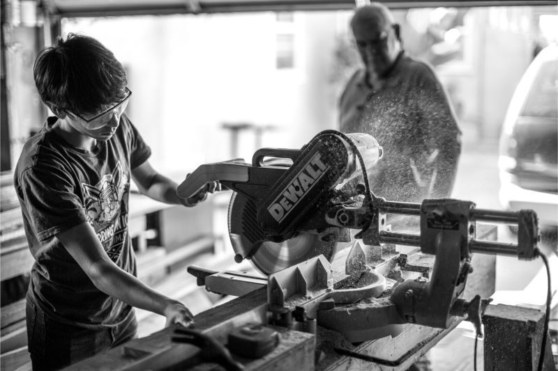 a boy working on a machine