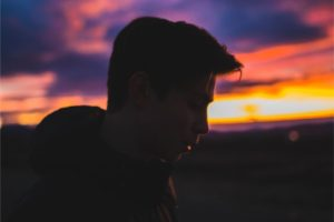 a young man with sunset